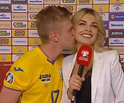 Canlı yayında spikeri öptü