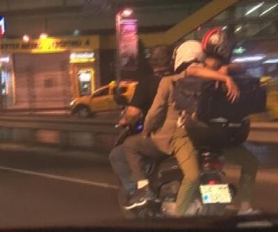 Motosiklete hem 3 kişi bindiler hem de valiz taşıdılar