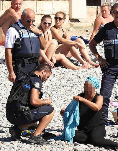 Fransız polisi plajda burkini giyen kadını soyunmaya zorladı